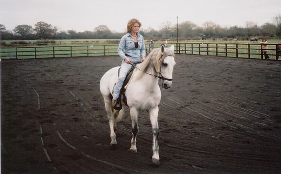 Pip Unwin Classical Natural Horsemanship Trainer riding and schooling her horse in Wellington Somerset near Devon