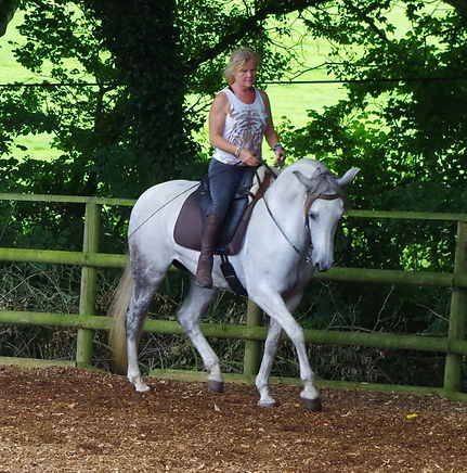 Philippa Unwin Classical Natural Horsemanship Trainer riding her horse with great affinity in Wellington Somerset near Devon.