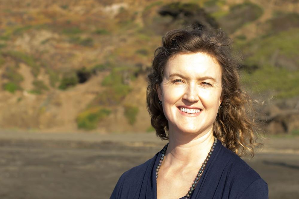 Photo of natural skincare founder Sarah Page at beach