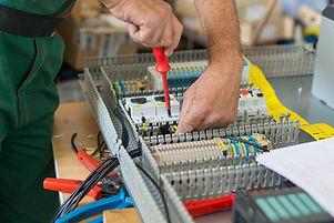 Electrician assembling industrial electr