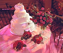 Wedding Cake with floral greets guests