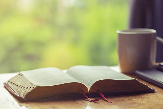 open-bible-with-cup-coffee-morning-devotion-wooden-table-with-window-light-resized.jpg
