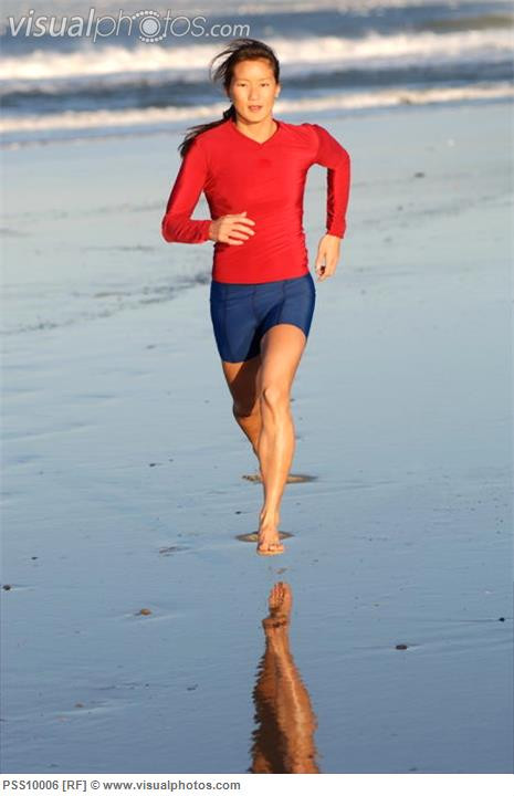 asian_woman_running_on_beach_.jpg