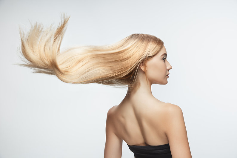 beautiful-model-with-long-smooth-flying-blonde-hair-isolated-white-studio-background-young