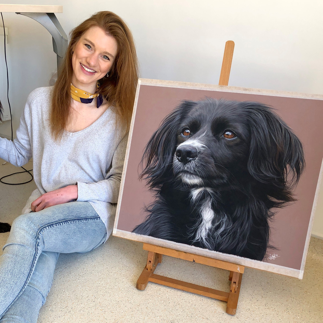 Sophie with drawing of her dog 'Badger'