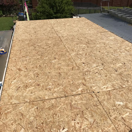 Fixing of 18 mm ply flat roof decking with insulation