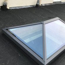 Fixing of sky lanterns on a Danosa high performance flat roofing system