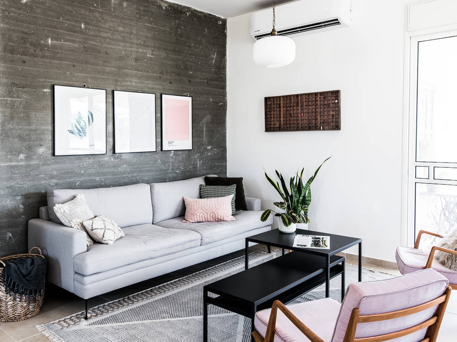 Living room with exposed concrete wall