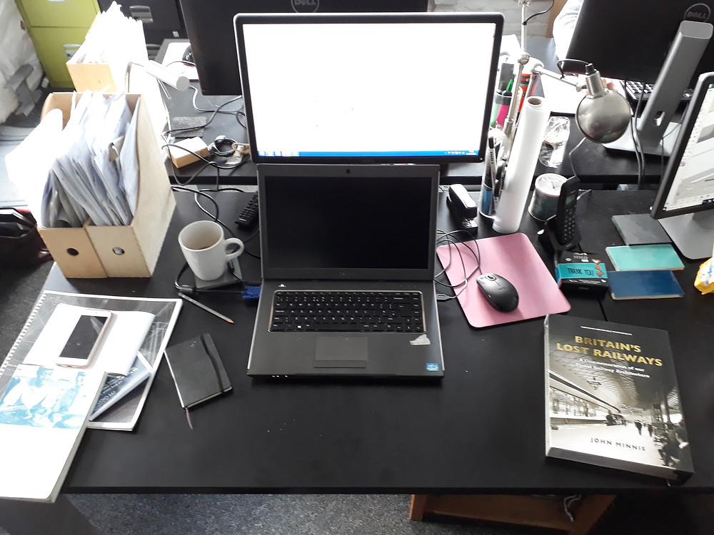 A typical architect's desk - how many different modes of communication are visible?