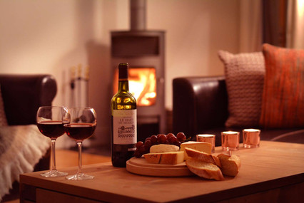 Cosy interior, cheese and wine by the fire