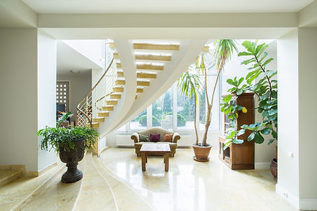 Interior home photo of beautiful curved stairway