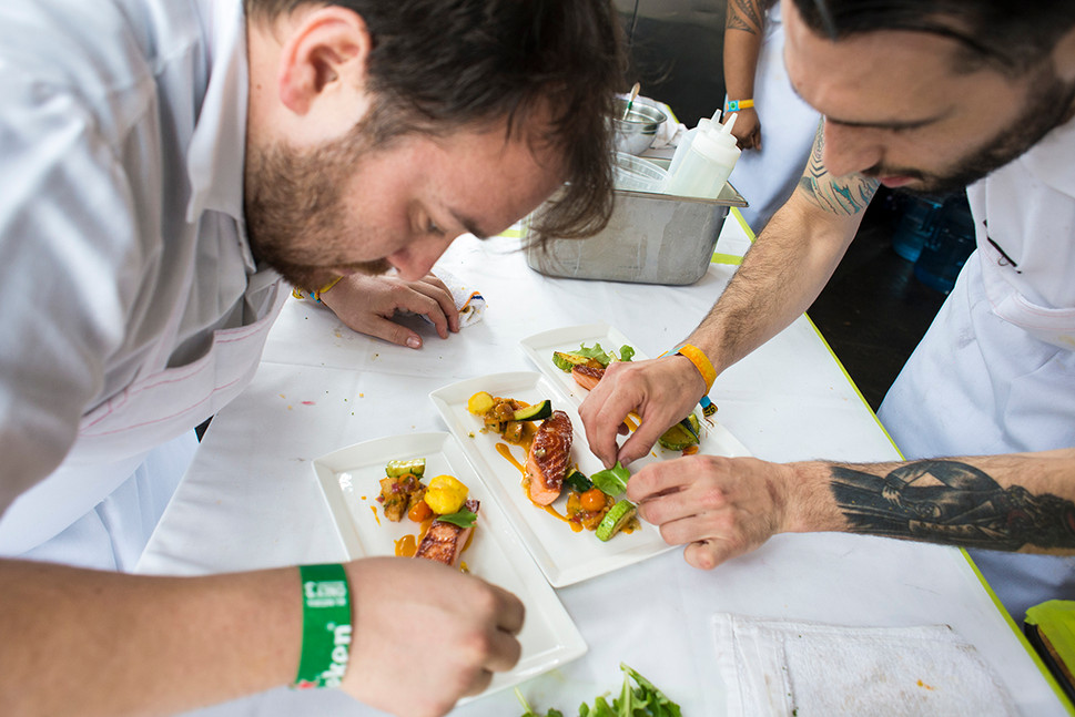 chefs-preparing-food-at-forest-feast-by-