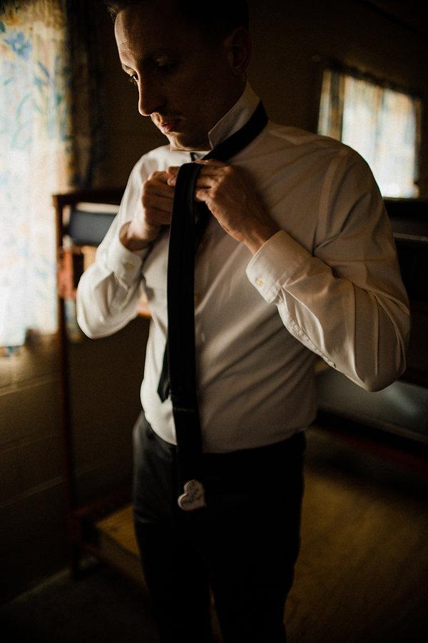 groom getting ready moody