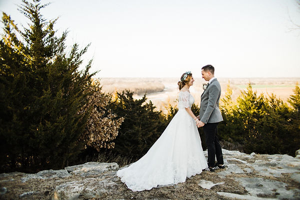 bride and groom first look in mountains