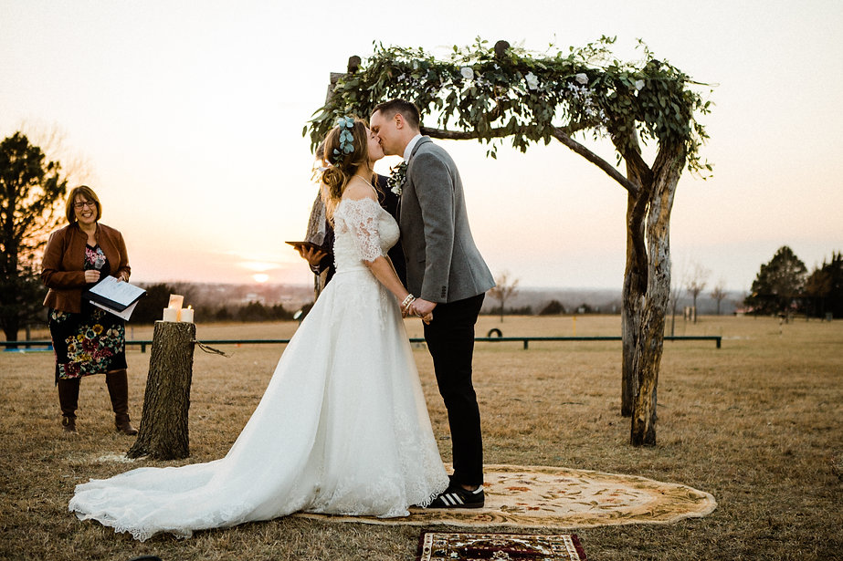 bride and groom kiss sunset