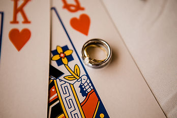 wedding ring on playing cards