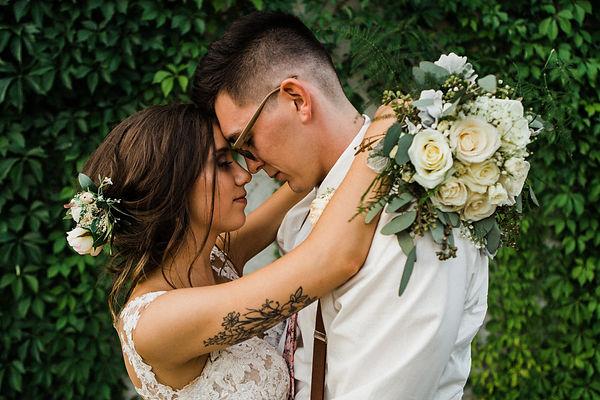 bride and groom vine wall
