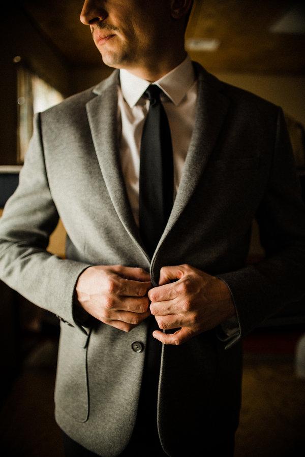 groom getting ready dark and moody