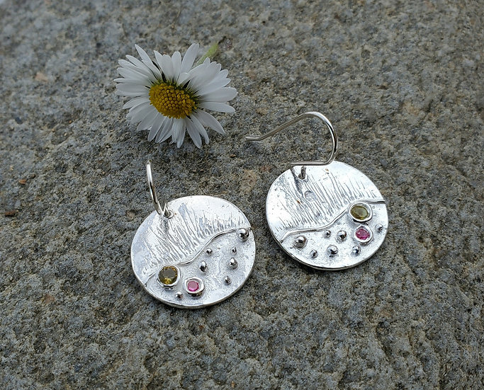 Silver earrings set with cubic zirconia