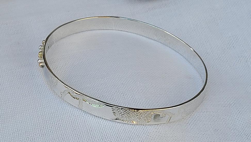 Gold ball silver impressed bangle