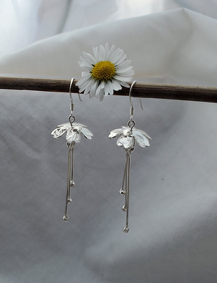 Silver floral dangly earrings