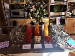 cocktail mixes and glasses on table