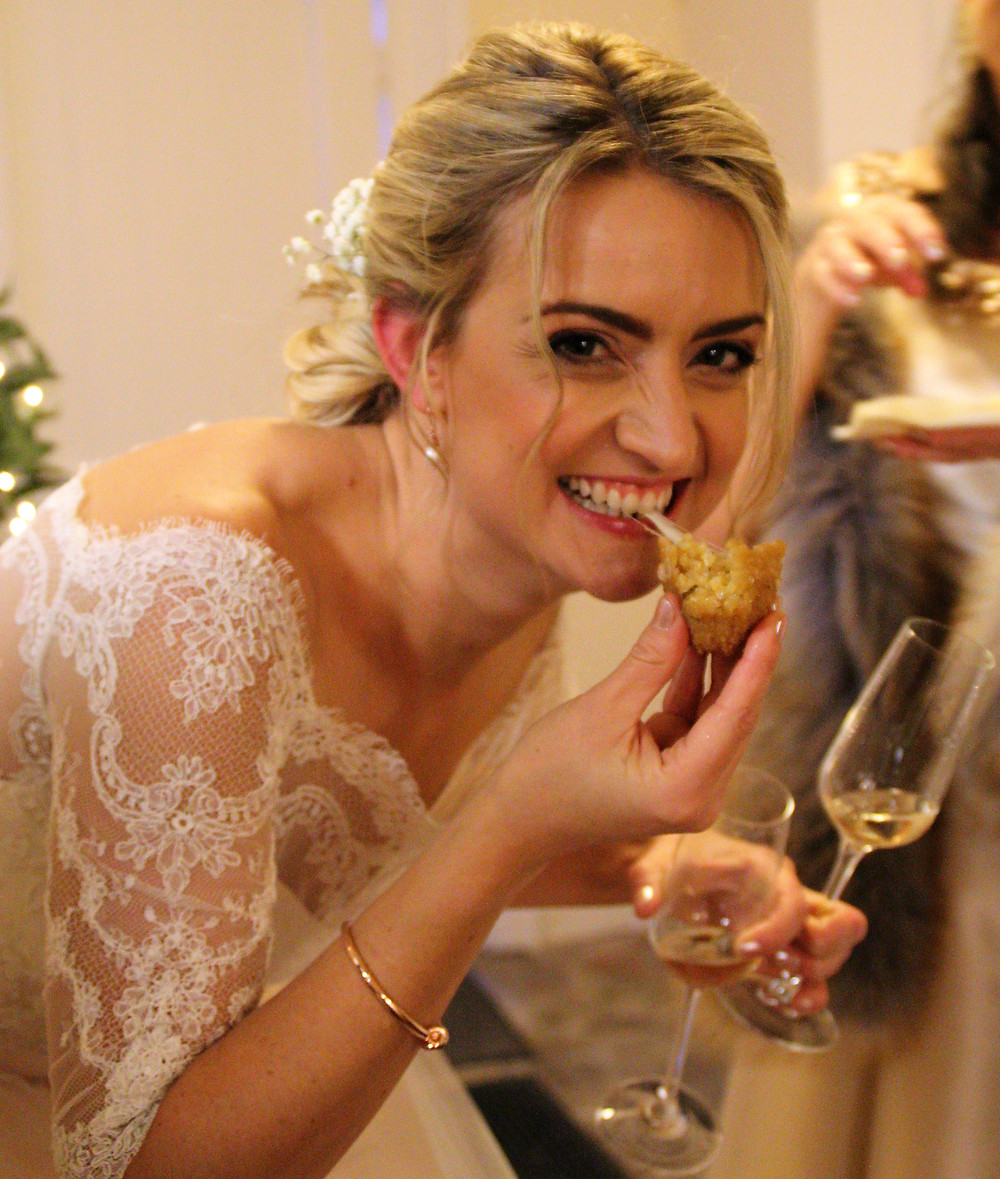 Bride enjoying canapes on her wedding day
