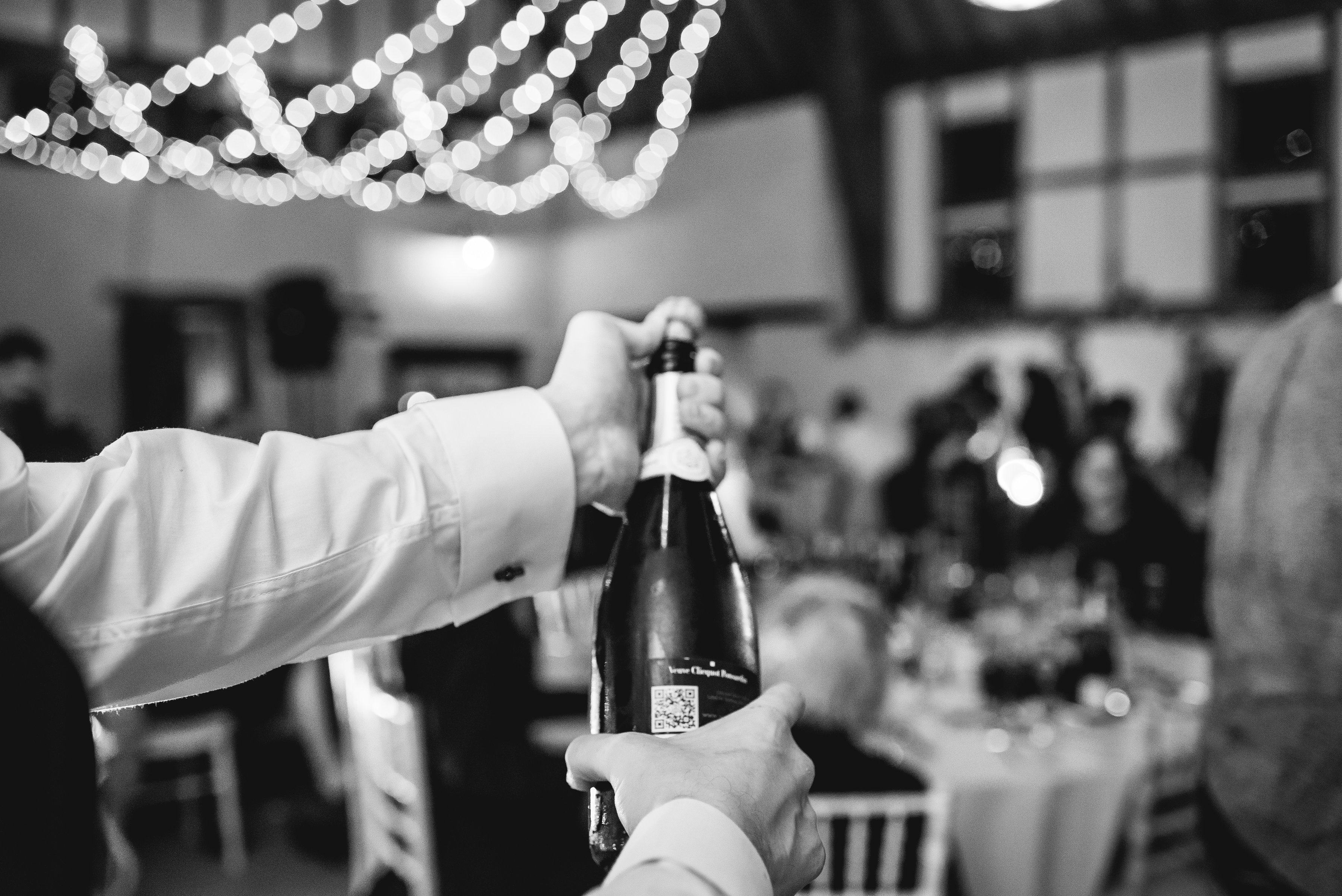 Champagne opening at wedding breakfast