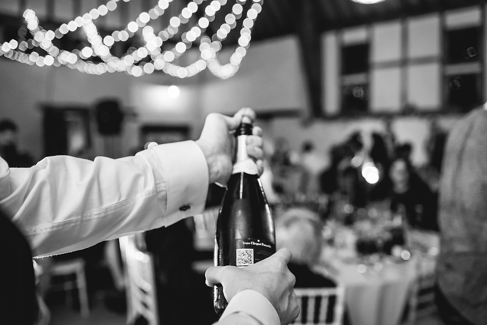 Celebrating with champagne at the wedding breakfast