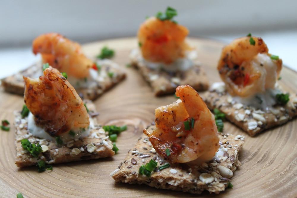 garlic king prawns with chilli on a melba toast