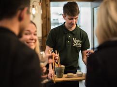 Virgins & Castle team serving bar snacks