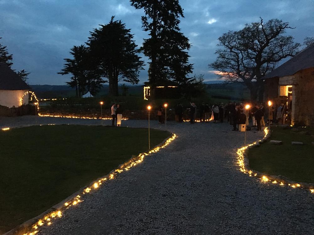 Evening wedding outside barn in Devon