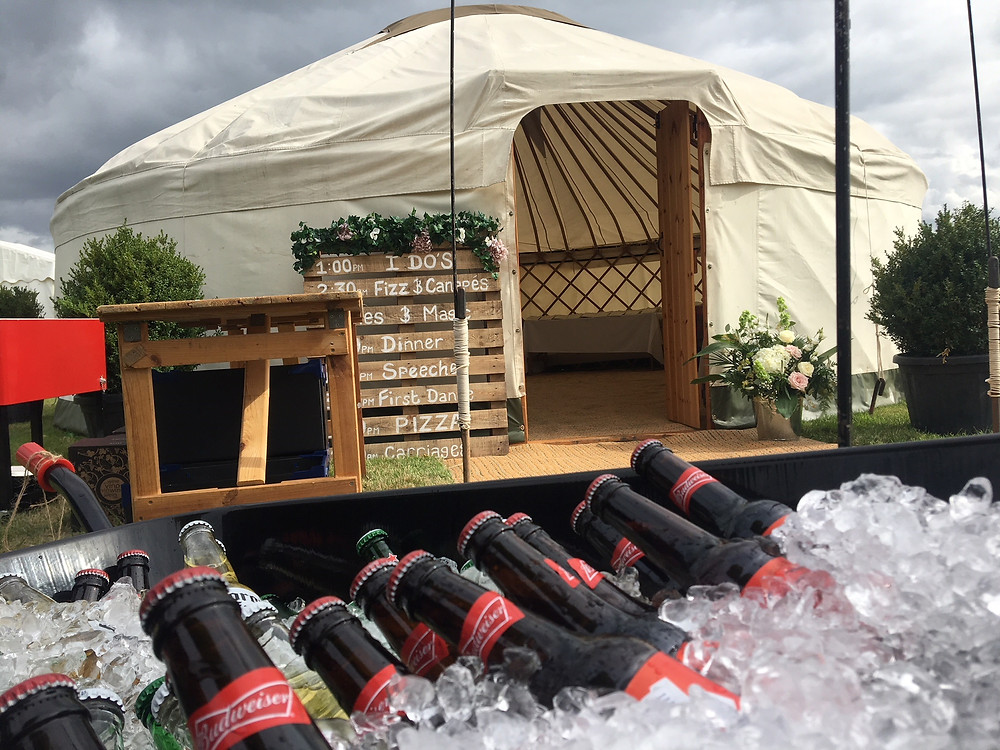 Wedding drinks reception with beers in wheelbarrows