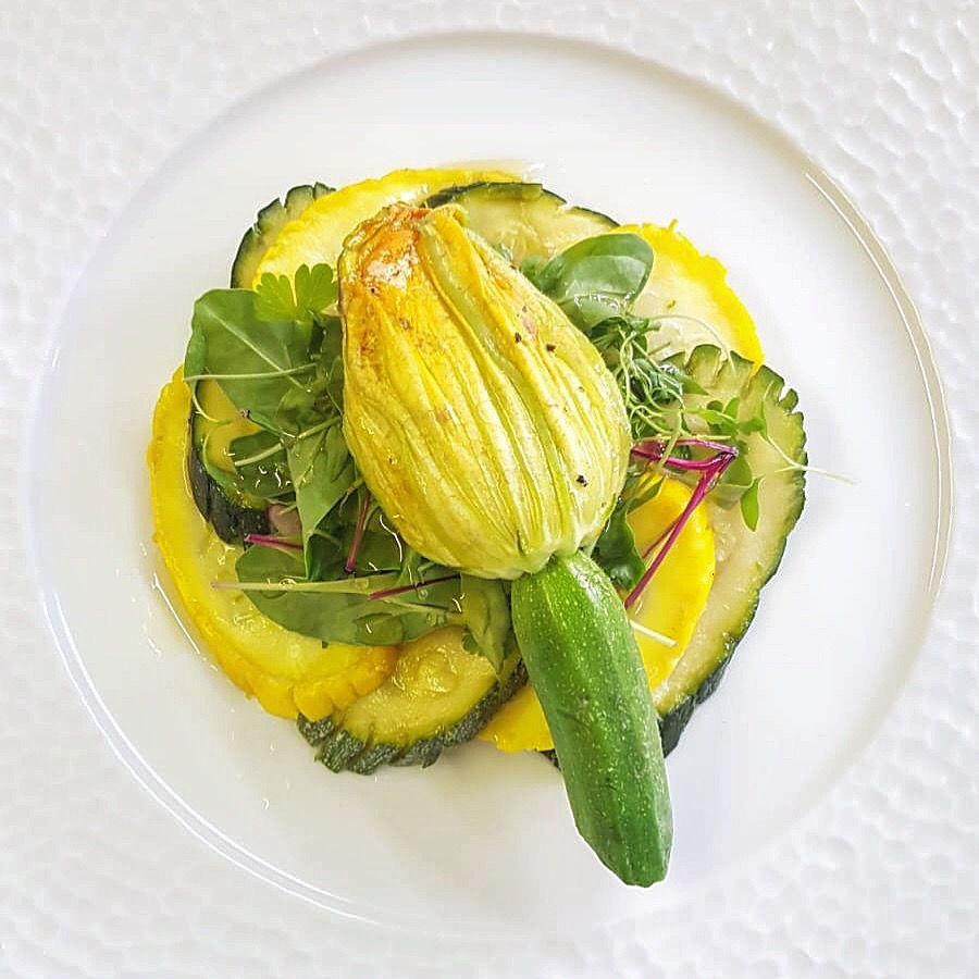 Stuffed courgette flower starter course.