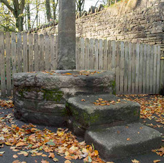 A STONE MOUNTING BLOCK IN THE PLAYGROUND OF RIVINGTON SCHOOL. LANCASHIRE