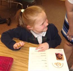 First grade with passport.jpg