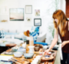 Shop Owner Arranging Merchandise
