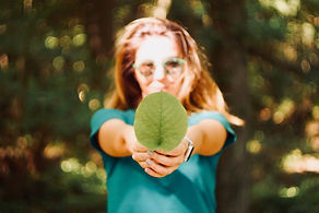 Picture of woman holding a leaf