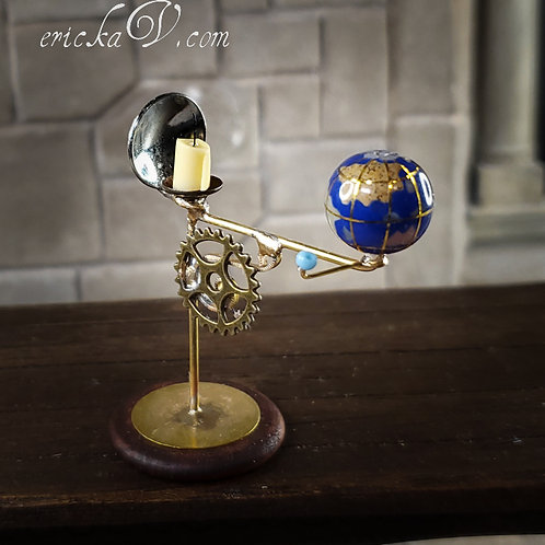 Candle and Blue Planet Orrery