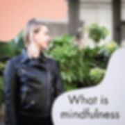 """Mindfulness means paying attention in a"