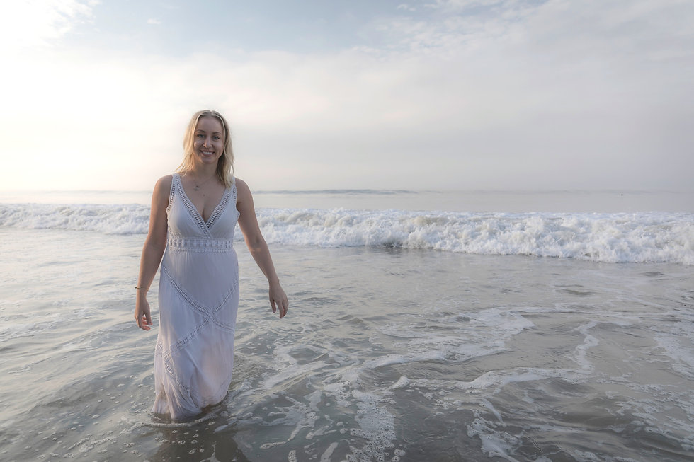 Dr. Carissa Gustafson looking calm and happy in the waves in Malibu