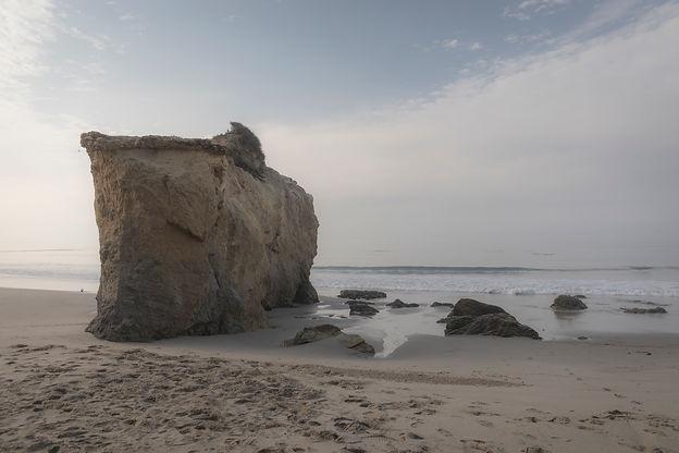 Waves crash on El Matador Beach in Malibu at sunrise
