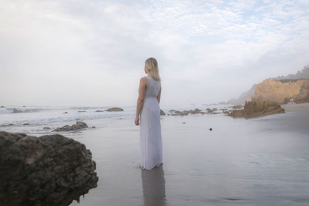 Carissa, a mindfulness-based therapist for millenials in LA, looks over the ocean in Malibu California