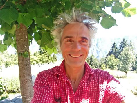Amrit at home under linden tree.jpg
