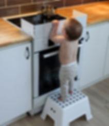 kid on plastic stool scaled.jpeg