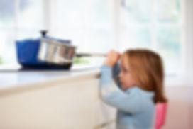 kid pulling pan scaled.jpeg