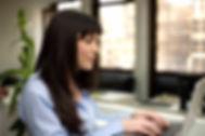 woman typing at keyboard