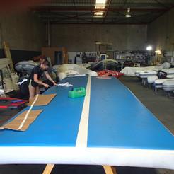 Inflatable gymnastics mat repair