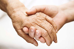 carer and elderly hand linked