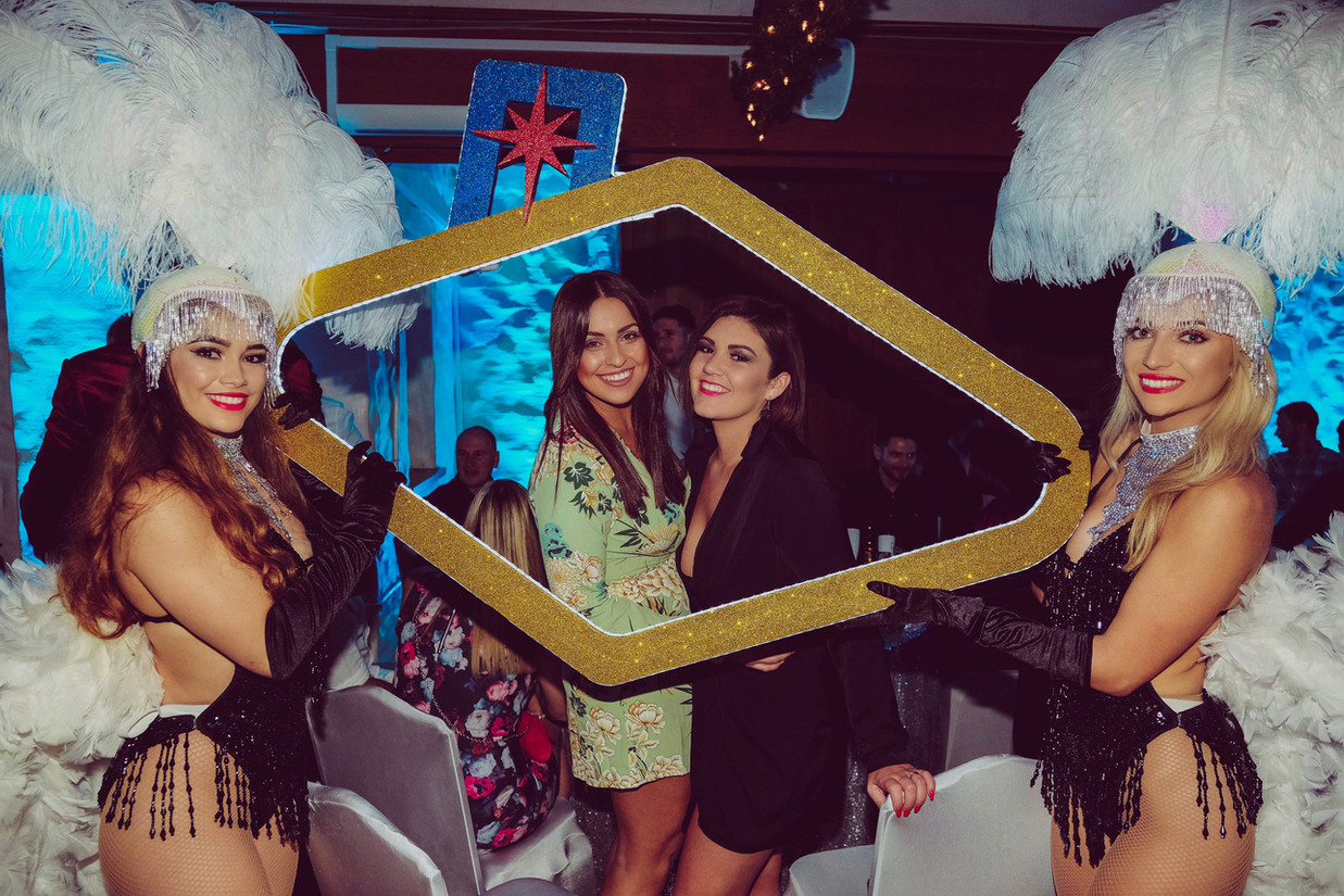 Guests posing with Vegas photo frame